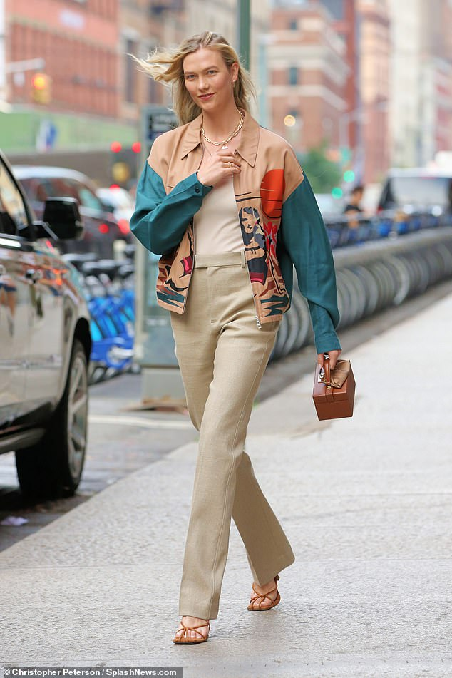 Glamorous: Supermodel Karlie Kloss, 28, looked svelte in a beige ensemble and a striking jacket as she headed to dinner with her husband Josh Kushner in New York City on Monday
