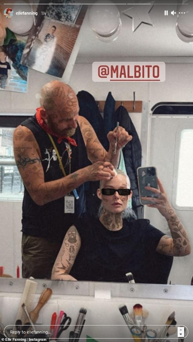 Different look: Elle Fanning played with a quirky tattoo filter as she shared a new snap getting her hair and makeup done behind the scenes of a mystery project on Tuesday