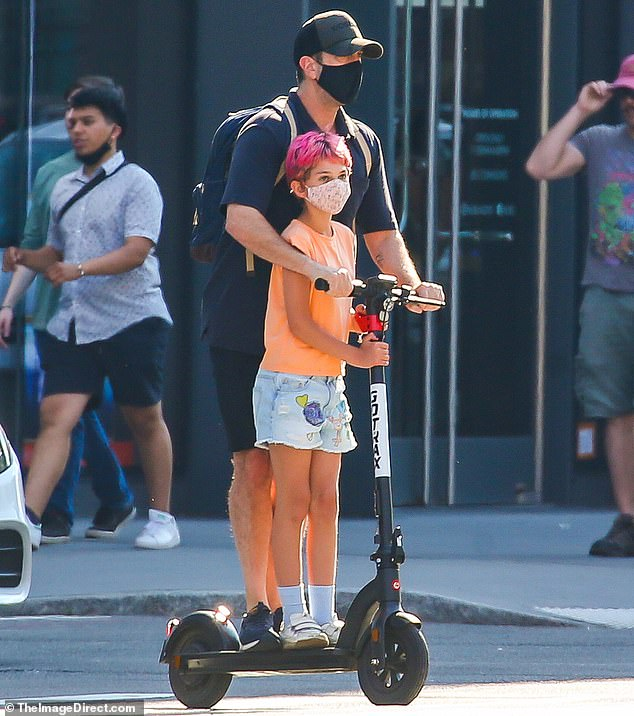 Taking a chance:The Friends actor stood behind his little girl who showed off a head of short hot pink locks after shaving her head last year. They were both helmet free