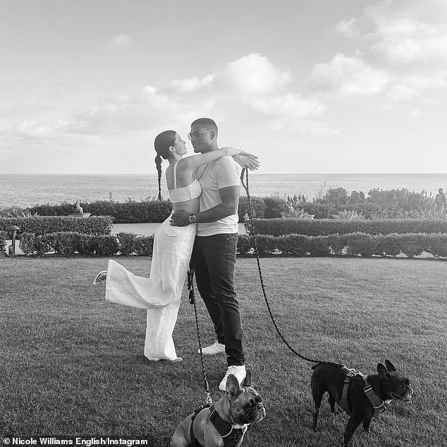 'Make someone smile today!' Williams and retired NFL linebacker Larry English just celebrated their fourth wedding anniversary at the Montage Laguna Beach (where they wed) with their pet French Bulldogs on May 19