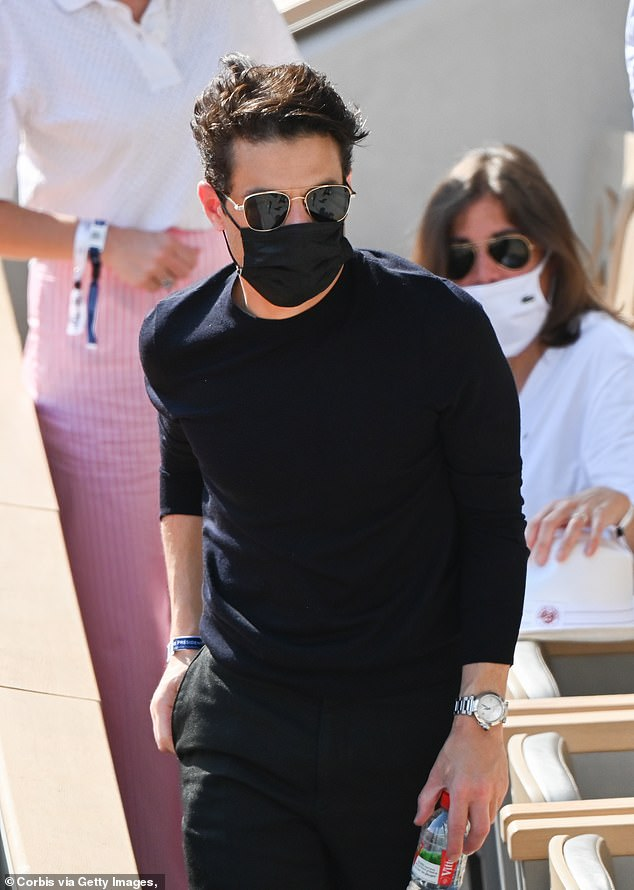 Looking good: Rami looked stylish as he exited the box during the day