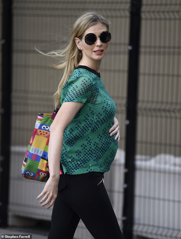 Bump:The beauty, 35, placed her hand on her growing bump as she put on a stylish display in a green printed top