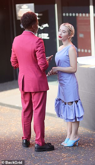Discussion: Ella boosted her height with turquoise open-toe heels and rocked a slick of red lipstick as she was seen talking to Nicola outside the screening venue