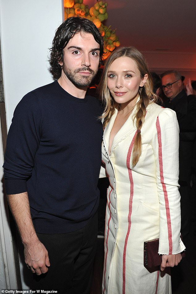 'Her husband!' Elizabeth Olsen has revealed she has married her partner Robbie Arnett after she called him her 'husband' during a WandaVision interview on Tuesday (pictured in 2018)