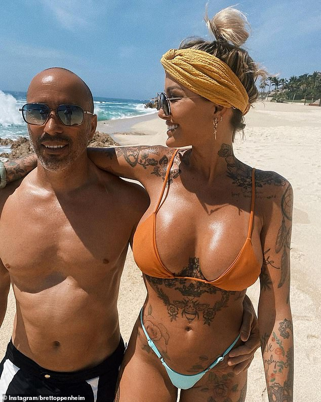 New flame: Tina confirmed her relationship with Selling Sunset's Brett Oppenheim (left) in April when they went 'Instagram official' on holiday