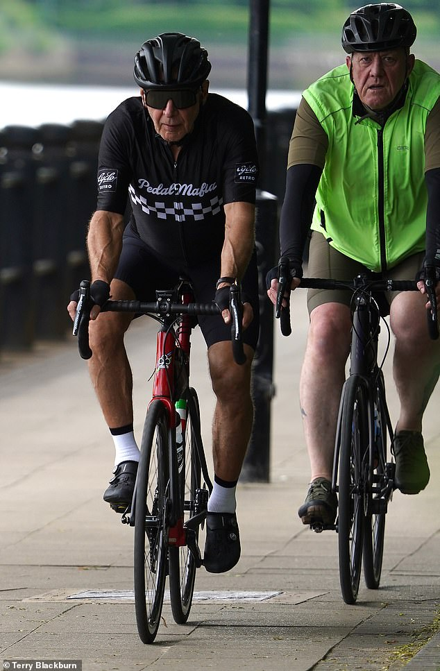 Long way from Tinseltown: Harrison was also seen cycling along the River Tyne in Newcastle on Tuesday