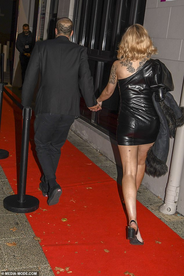 Gorgeous: The 31-year-old reality star looked sensational in a tight pleather dress, which showed off her svelte pins and tiny waist to perfection