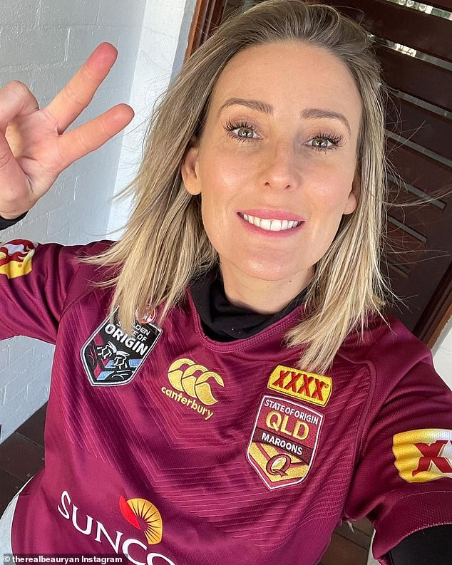 Cheeky:WAG Kara Ryan sent a selfie of herself dressed in a Queensland Maroon's Jersey to rile up her husband, The Footy Show star and Blues supporter, Beau Ryan on Wednesday