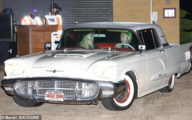 Vintage: The happy couple were seen driving away in a vintage cream Cadillac Coupe DeVille with red leather interior
