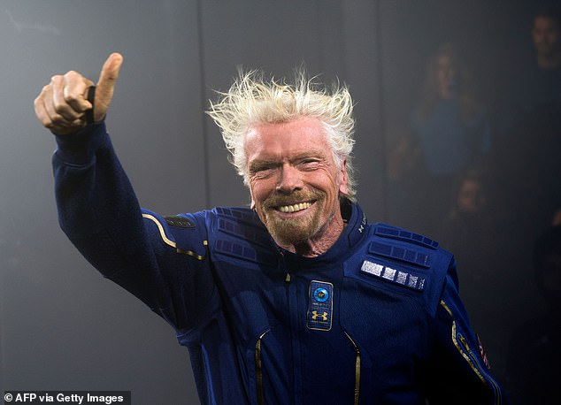 The new space race: Virgin Galactic founder Sir Richard Branson (pictured) could beat Jeff Bezos to space by flyingon his VSS Unity SpaceShipTwo rocket plane over the July 4 weekend, according to a report, two weeks before the Amazon CEO launches with Blue Origin on July 20