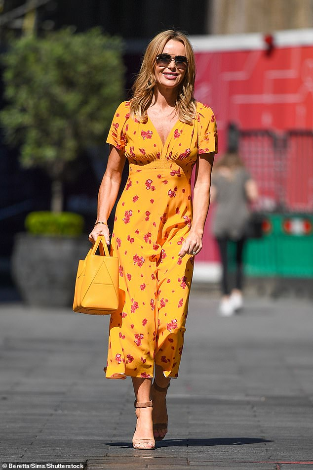 Wow! Amanda Holden was once again showing off her fashion credentials as she left her Heart FM shift at Global Studios in central London on Wednesday in a yellow ochre floral dress