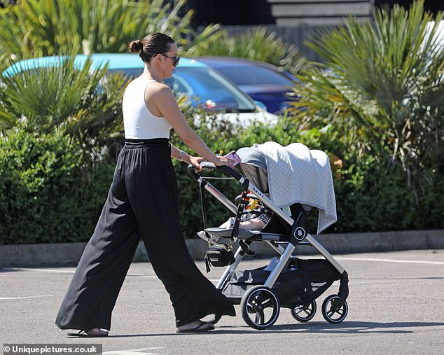 Flattering: Shelby looked great in her monochrome outfit as she pushed the pram
