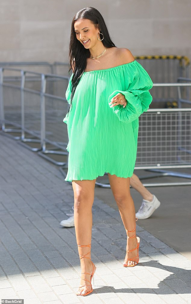 Beauty: The presenter, 26, teamed the green number with orange strappy sandalls