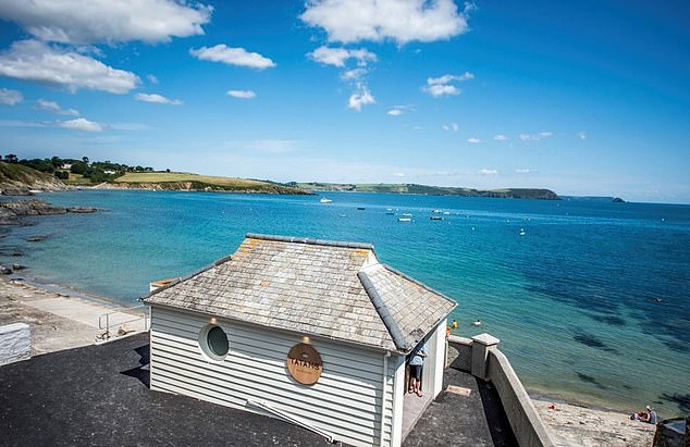 Tatams, pictured, is right beside Portscatho's rocky shore and is built inside a former public toilet block