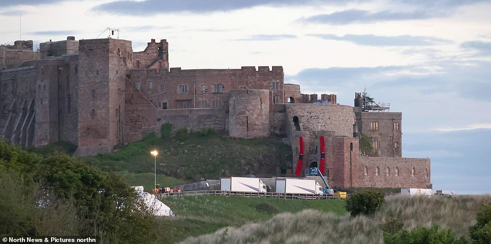 On location: The actor was seen in Newcastle, as he cycled along the banks of the River Tyne, 50 miles from where production is taking place on the sequel at the supposedly haunted Bamburgh Castle [pictured on Tuesday]