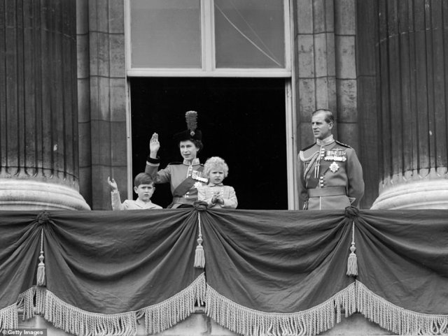 1954 — THE PRINCE AND PRINCESS SAY HELLO: In the first balcony photos from Trooping the Colour, the young Queen waves to the crowd below with Prince Charles (left) and Princess Anne. Prince Philip stands off to the right, surveying the festivities. Months earlier, the 27-year-old Queen made waves when she became the first and only reigning monarch to visit Australia. Since that first visit in 1954, she has returned 15 times.