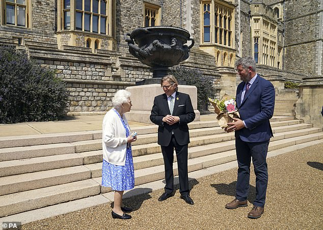 Philip was also a committed conservationist who took a deep personal interest in the management and running of all the royal estates. Pictured, the Queen and her guestKeith Weed