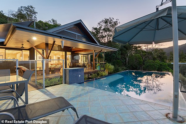 What a pad: The home is an entertainer's dream for Kyle and his girlfriend, Tegan Kynaston, and features a blue-tiled infinity pool which looks out to the hinterland