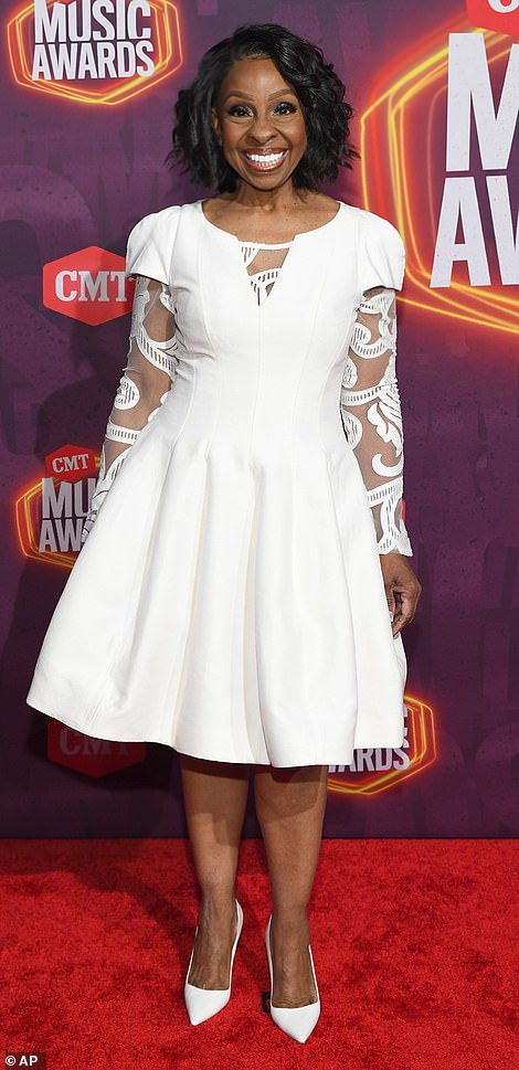 Elegance: The 77-year-old star wowed in an elegant white dress that stopped at her knees and featured flattering lace sleeves