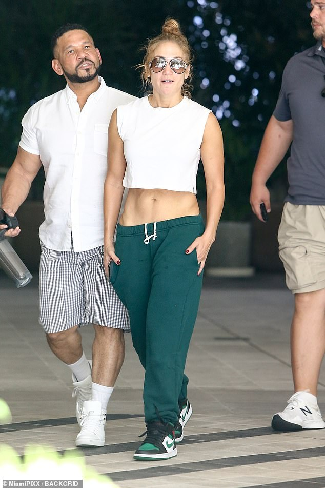 Ab fab!Jennifer Lopez sent temperatures soaring on her own as she stepped out in Miami on Wednesday with her manager Benny Medina with her washboard abs on full display