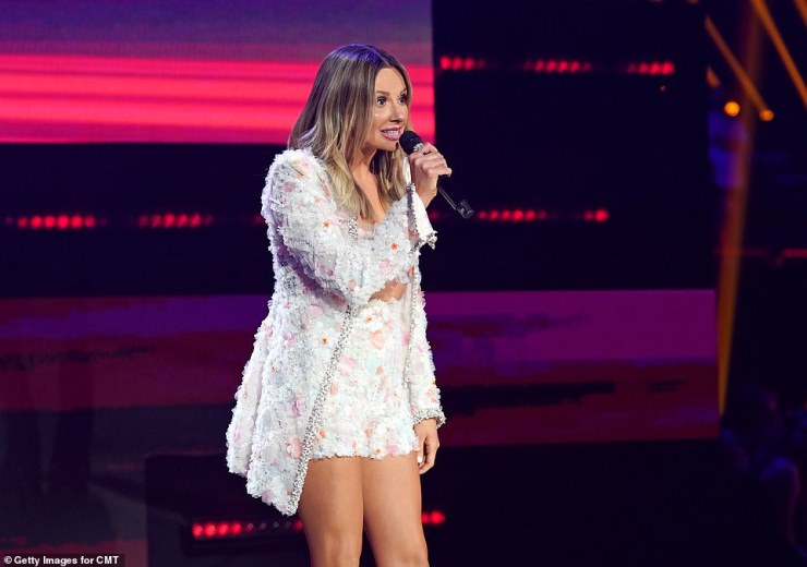 Back at it: Nominee Carly looked lovely in feathery white shorts and a matching jacket when she stepped out to introduce the next performer, Thomas Rhett.
