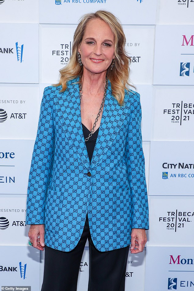 Helen's look:Hunt stepped out wearing a low-cut black top under a bright blue Gucci sport coat with a black checkered pattern