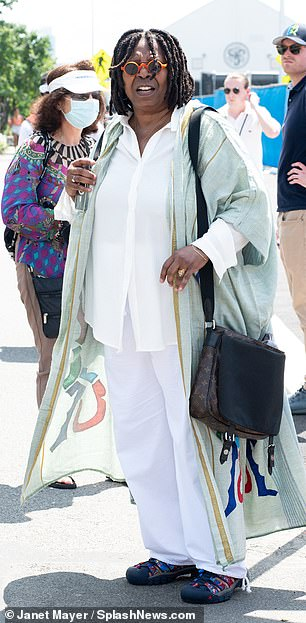 Whoopi Goldberg wore a white cotton shirt and matching pants with a patterned duster