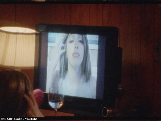 Taking control: Various clips of Lourdes parading around the motel room, smooching a stuffed bear, and puckering up for the camera play out on a display of television screens, with the voyeur looking on in amazement