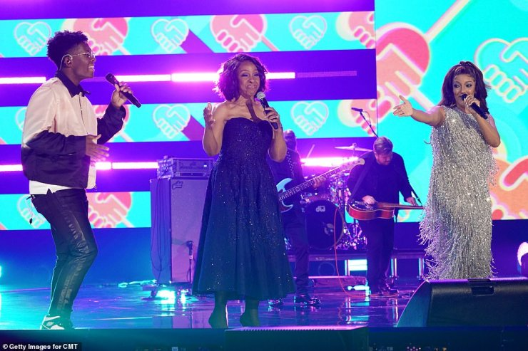 Sing it!The performance started off with Mickey, 37, and Breland, 25, performing their new collaboration Cross Country, before the songstress was joined on stage with none other than Gladys, 77, herself for Friendship Train