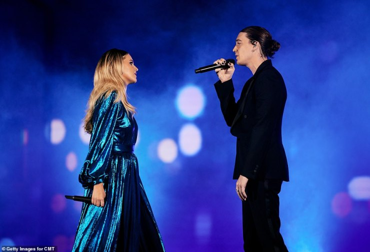 Eye to eye: The performance began with the duo on opposite ends of an aisle, before they moved closer to one another