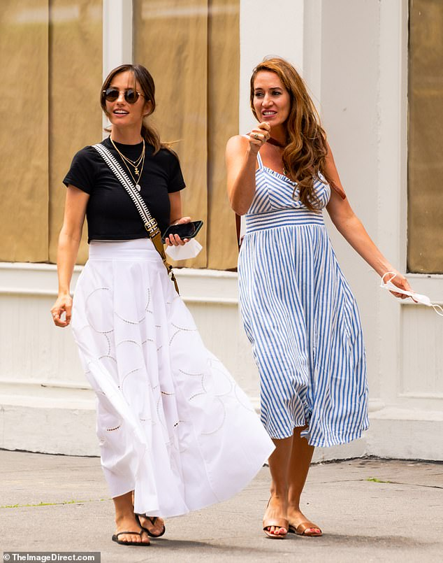 Casual elegance: The Friday Night Lights alum looked summer ready dressed in a long white-patterned skirt, black crop top and flip-flops, while her girlfriend went with a blue and white candy stripe dress and sandals