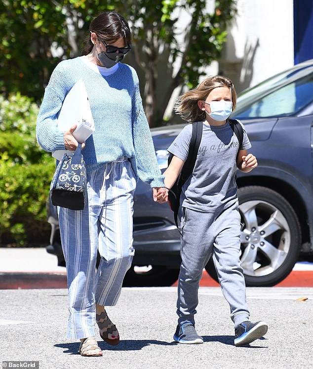 Chauffeuring the kids: Jennifer Garner, 49, was spotted shuffling her youngest child, nine-year-old Samule, to a play date in Santa Monica on Wednesday