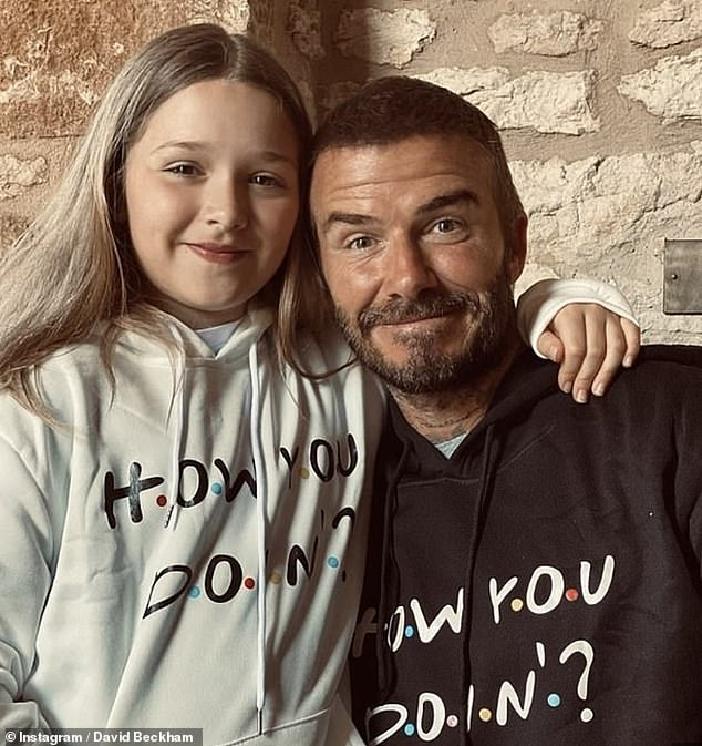Close bond:The football star, 46, often shares snaps with his youngest child and only daughter (pictured in matching Friends hoodies last summer)