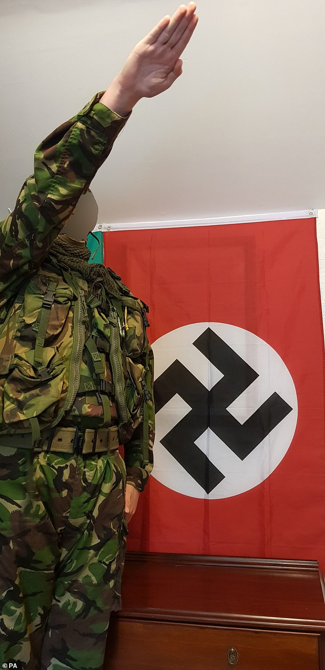 In February, Britain's youngest convicted terrorist who led a Hitler-worshipping cell from his grandmother's cottage in rural Cornwall walked free from court after being spared jail. He is seen making a Nazi salute, but can't be identified due to his age
