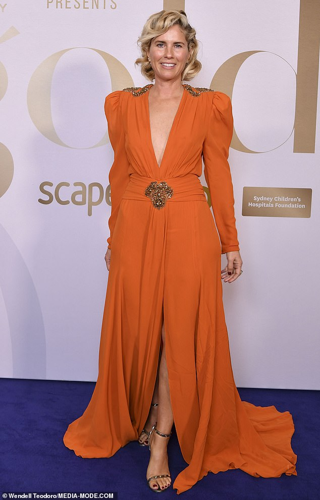 Making a statement! Fashion designer Sarah Jane Clarke (pictured) made a statement in a long orange frock which featured a plunging neckline