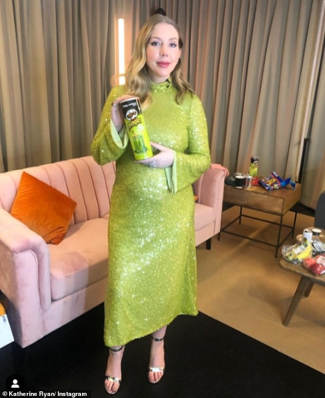 Vision in pickle green:Katherine Ryan, 37,shared a snap in a bright green dress while holding a tube of Screamin' Dill Pickle Pringles in the same shade on Instagram on Thursday