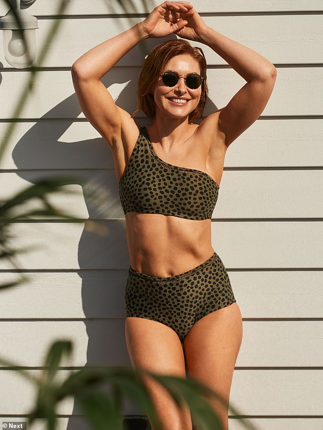Ab fab!In a different swimwear ensemble, the TV star worked her best angles in a green animal print £44 two-piece which had an asymmetrical top and high-waisted bottoms
