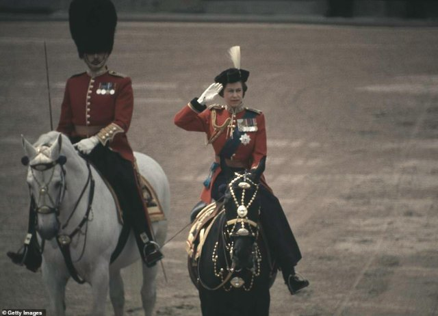 1971 — HAPPY BIRTHDAY TO HER MAJESTY:Queen Elizabeth II sits astride her horse Burmese as she makes her way from Buckingham Palace along the Mall to Horse Guards Parade during the Trooping the Colour ceremony on the Queen's official Birthday Parade in London.