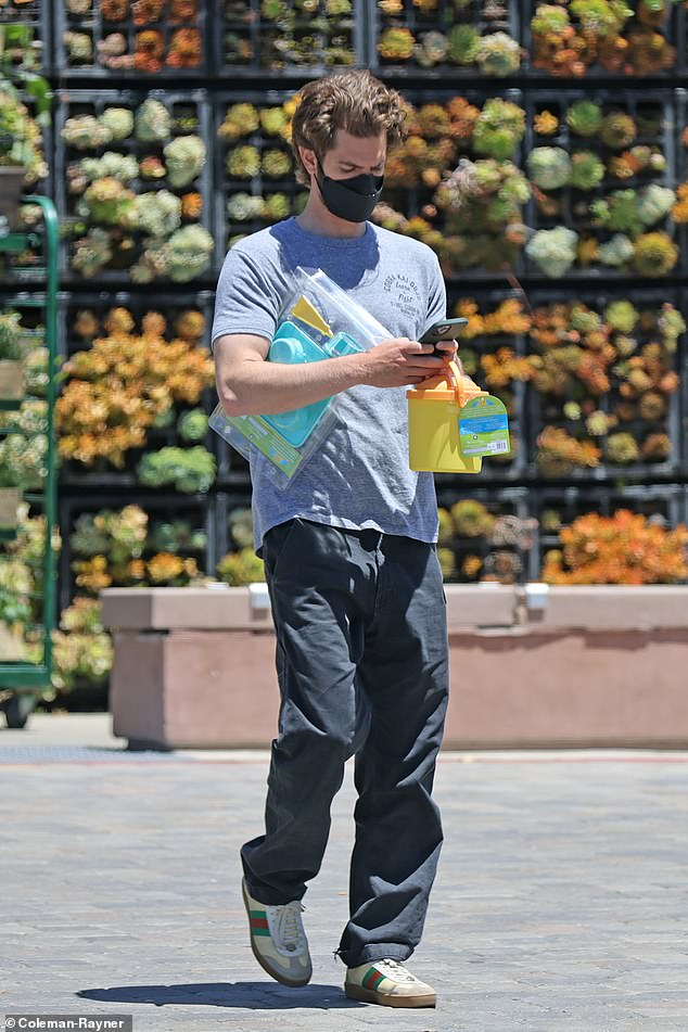 Casual: The Spider-Man star caught running errands in a laid-back look of a grey T-Shirt, black cargo pants and trainers