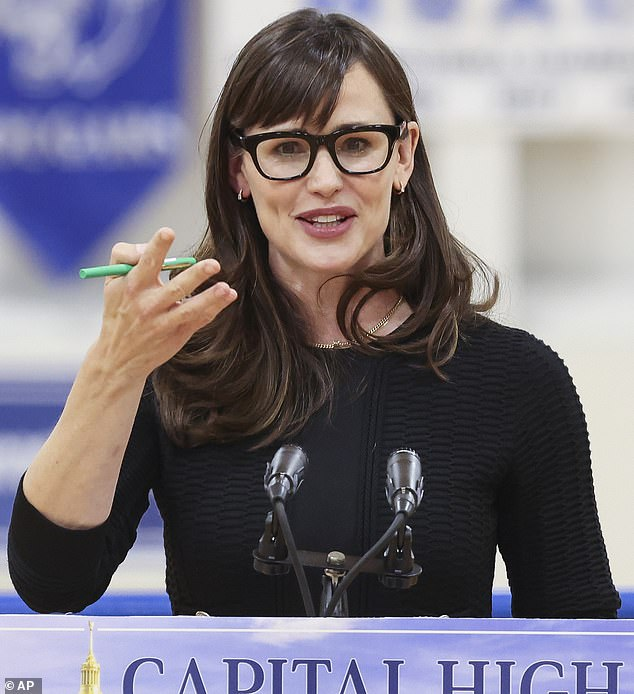 I am OK! Jennifer Garner is 'accepting' of Ben Affleck's relationship with Jennifer Lopez; Garner seen in mid May in West Virginia