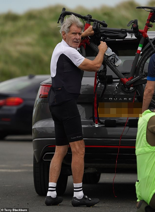 Break:The iconic actor, 78, displayed his toned physique in cycling gear which included a black waterproof GORE-TEX jacket and shorts