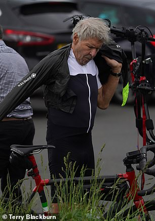 Start-studded appearances: The diner wasn't the only local spot Harrison has visited, as the day before he also delighted the staff at Sigma Sports bicycle shop at Hampton Wick