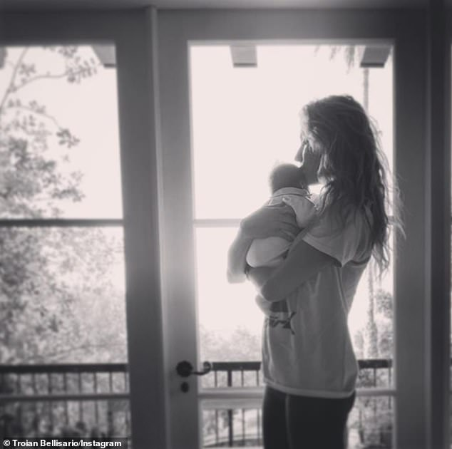 Dramatic entrance! Pretty Little Liars alum Troian Bellisario and Suits alum Patrick J. Adams just detailed the 'wild' birth of their second child - daughter Elliot Rowena Adams - on May 15