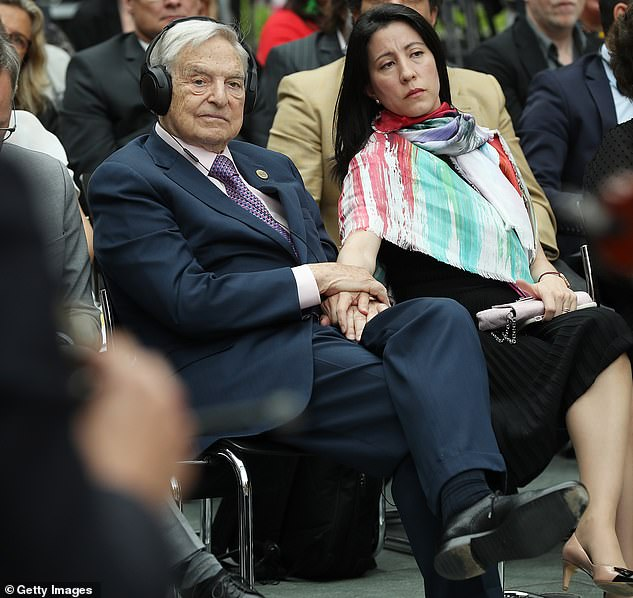 George Soros, the founder of Soros Fund Management, has an estimated wealth of $8.6 billion. He paid no federal income tax between 2016 and 2018, according to the records. He is pictured with wifeTamiko Bolton