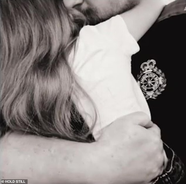 The black and white photo (pictured) 'Be Safe Daddy' (pictured) shows Poppy cuddling her father Mark before he left to work as a paramedic during the coronavirus crisis