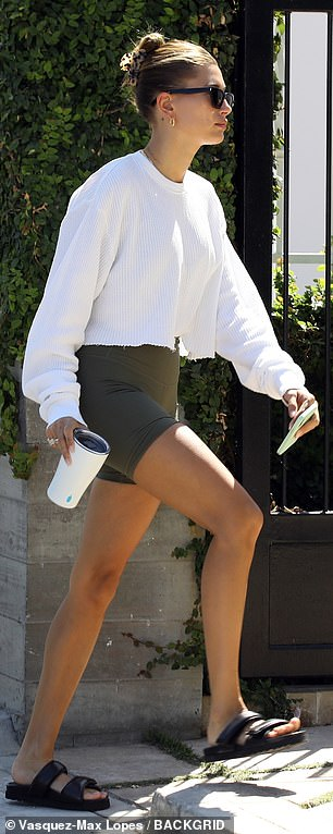 Just the essentials! She carried just her reusable white cup and cell phone