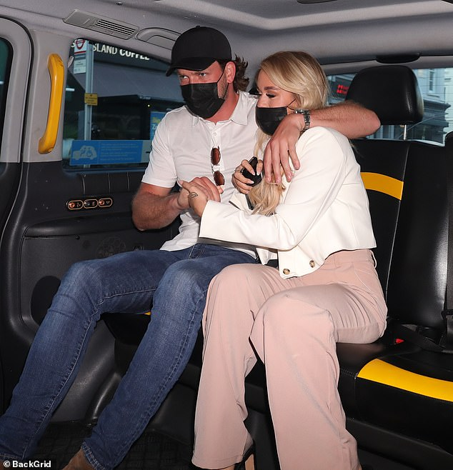Loved-up:The influencer, 22, and the former tennis player, 29, put on a cosy display as they wrapped their arms around each other and snuggled in their taxi home