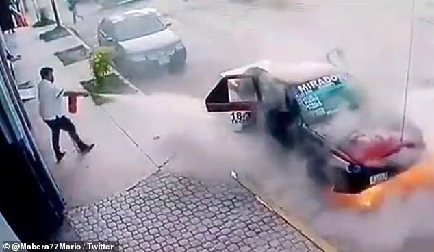 A man stepped out of a shop in Oaxaca, Mexico, and used a fire extinguisher to put out the flames