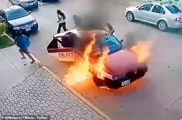 Passengers flee the burning taxi moments after the driver had opened the hood to inspect the engine