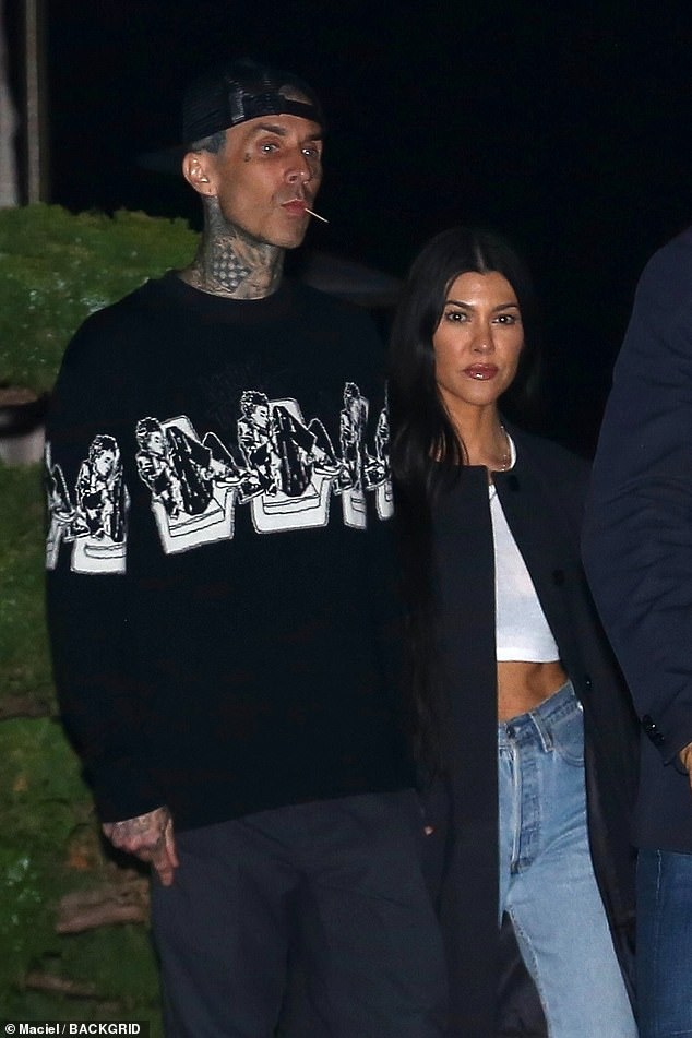 It's on! Kourtney and Travis are in the throes of a very PDA-packed romance (pictured 2021)